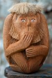 Handmade wooden monkey with unspoken gesture Stock Image
