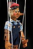 Handmade wooden puppet Pinocchio. Stock Photo