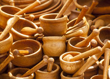 Handmade wooden tableware. Many handmade wooden dishes on the table Royalty Free Stock Photo
