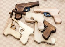 Handmade wooden toy pistols for children. Different handmade wooden toy pistols for children Stock Image