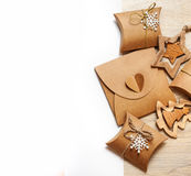 Handmade wooden toys and Christmas boxes for gifts of kraft paper Stock Image