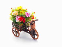 Handmade wooden tricycle toy with flower in the basket isolated Stock Image