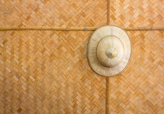 Handmade wooden wicker hat hung on a background pattern woven ba. Mboo royalty free stock photos