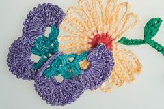 Handmade wool knitted flower and butterfly colorful texture background Royalty Free Stock Images