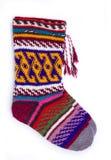 Handmade wool socks. Two handmade wool socks isolated on white stock images