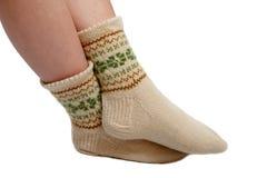 Handmade wool socks. Warm hand knitted wool socks on women foot Stock Images