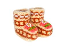 Handmade woolen baby booties, isolated on white stock photography