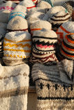 Handmade woolen hats and sweaters Royalty Free Stock Photo
