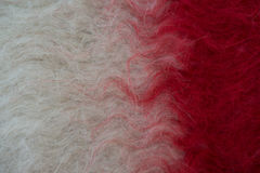 Handmade woollen felt blanket in white and red Royalty Free Stock Photo