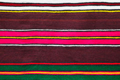 Handmade woollen rug with colorful stripes Royalty Free Stock Image