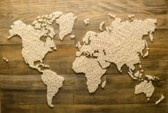 Handmade world map on wooden background for home decoration, top. View, flat stock image