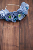 Handmade wraith of blue flowers lying on wooden background. Handmade floral wraith made of blue flowers lying on the dark brown wooden background. Shallow depth Royalty Free Stock Photography