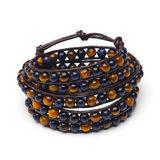 Handmade wrap bracelet. Of natural stone beads with tiger eye effect Royalty Free Stock Images
