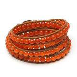 Handmade wrap bracelet. Of natural stone beads with tiger eye effect Stock Photos