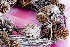 Handmade x-mas wreath on pink cloth Stock Photos