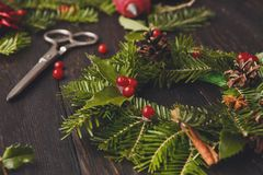 Handmde christmas wreath decoration on rustic wood background, vertical royalty free stock photos