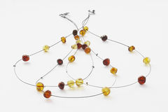 Handmade yellow amber necklace with  silver details. Stock Photos
