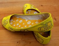 Handmade yellow shoes Stock Images