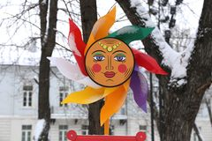 Handmadethe sun from plastic with multi-colored beams with a smile and eyes as a symbol of celebration of Maslenitsa. T multi-colored beams with a smile and eyes Stock Images