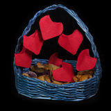 Handmaid basket with origami hearts for Saint Valentine`s Day on black background. Handmaid blue busket with bright red origami hearts for Saint Valentine`s Day Stock Photo
