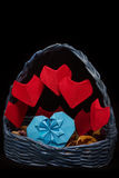 Handmaid busket with origami hearts for Saint Valentine`s Day. Handmaid blue busket with bright red origami hearts for Saint Valentine`s Day on black background Royalty Free Stock Image