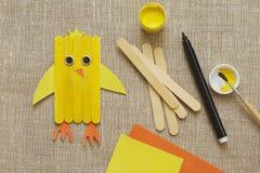 Handmake. Yellow chicken from wooden sticks on burlap royalty free stock image