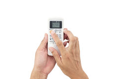 Handmannen asia rymmer en fjärrkontroll av luftkonditioneringsapparat 22 Royaltyfria Bilder