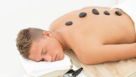 Handome guy getting spa treatment Stock Photos
