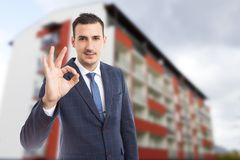 Handome real estate agent showing perfect gesture outdoors stock images
