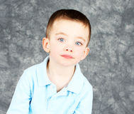 Handome  young boy with serious face Royalty Free Stock Photography