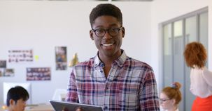 Handosme African american male executive using digital tablet in modern office 4k. Portrait of happy handosme African american male executive using digital stock video footage