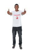 Handosme man wearing blood donor giving thumbs up Stock Images