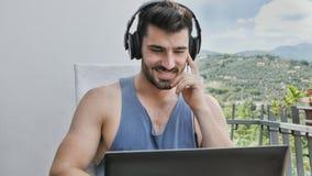 Handosme Man Working at Home at Laptop Computer royalty free stock photo