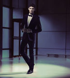 Handosme slim guy wearing black suit Stock Photo