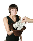 Handout. The girl holds a hat in which put dollars, isolated on white background Stock Photo