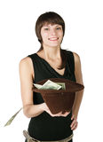 Handout. The girl holds a hat in which put dollars, isolated on white background Royalty Free Stock Photography