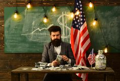 Handout and loan. handout concept with bearded man holding dollar money at usa flag. Handout and loan. handout concept with bearded man holding dollar money at royalty free stock photos