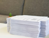 Handout at office. Stack of paper was put on table at office environment Stock Photography