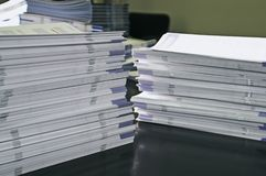 Handout papers. Piles of handout papers lying on table royalty free stock photos