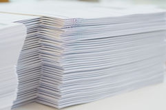 Handout on table at office. Stack of paper was put on table at office environment royalty free stock photography
