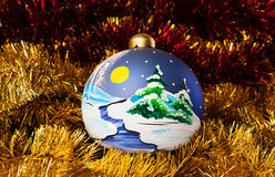 Handpainted christmas balls with tinsel. New year decorations. Hand painted Christmas balls with tinsel Stock Image