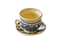 Handpainted cup and saucer isolated on white Stock Photography