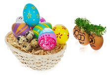 Handpainted Easter eggs in funny scared and surprised cartoonish. Faces with cress like hair. Handmade eggs look at the outstanding foreign individual egg in Royalty Free Stock Photography