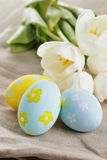 Handpainted easter eggs and white tulips on wood royalty free stock image