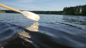 Handpainted Old Wooden Oar Pull Lake Water and Make Splashes. HD Slowmotion Nature Lifestyle Footage.