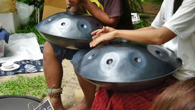 Handpan drum playing beautiful song  in the park Stock Photography