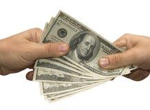 handpengar annan över Arkivfoton