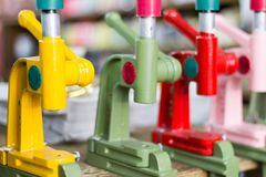 Detail of manual hand press buton machines with blurred background. Saara, Rio de Janeiro, Brazil. 2019 royalty free stock images