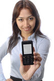Handphone. A pretty young woman holds up a handphone Royalty Free Stock Images