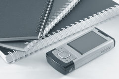 Handphone and notepads Royalty Free Stock Photos